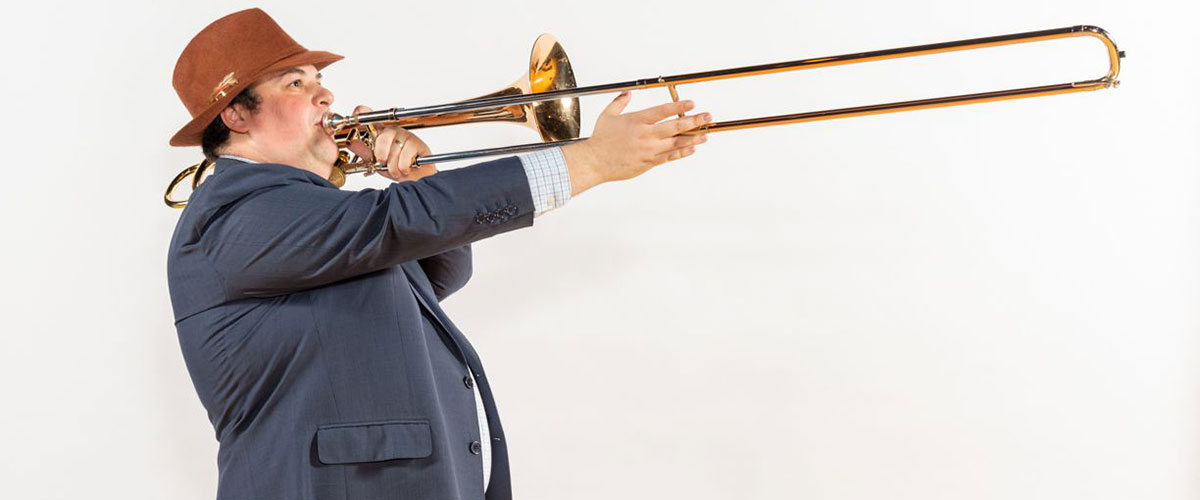 Dan Blacksberg pictured playing trombone