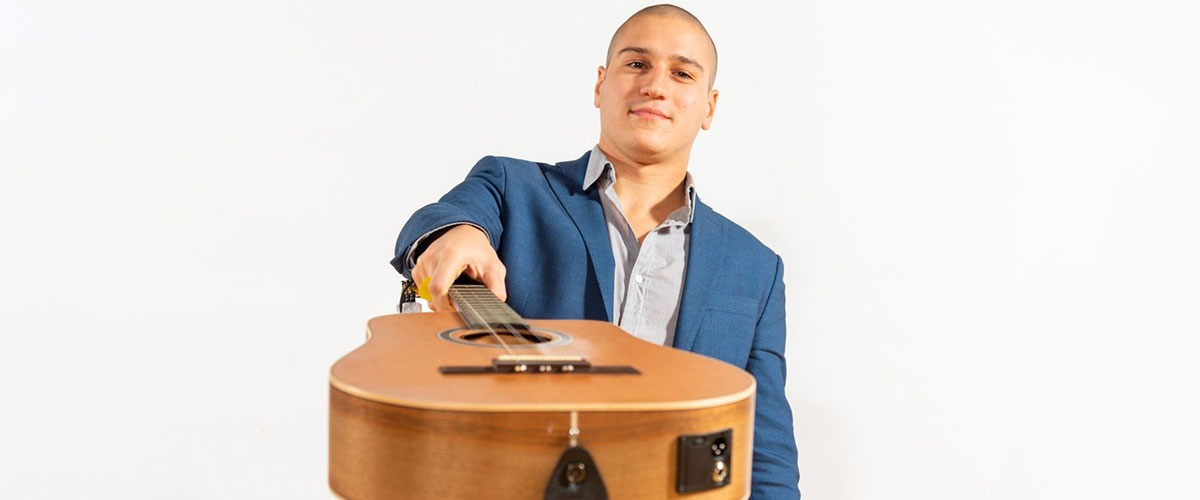 Dariel Peniazek Pictured with Guitar