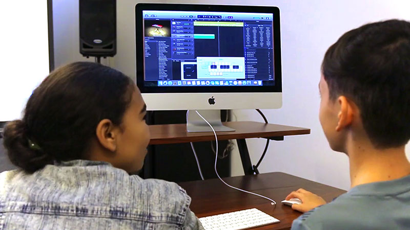 Two students work on a music program on the computer at the Kimmel Center