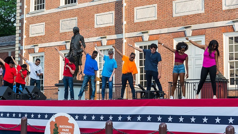 Students perform on stage at Wawa Welcome America