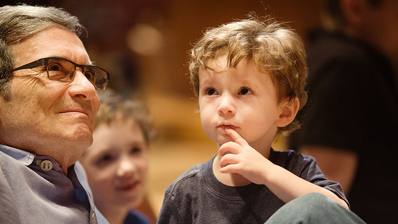 young boy and man listening to the organ demonstration