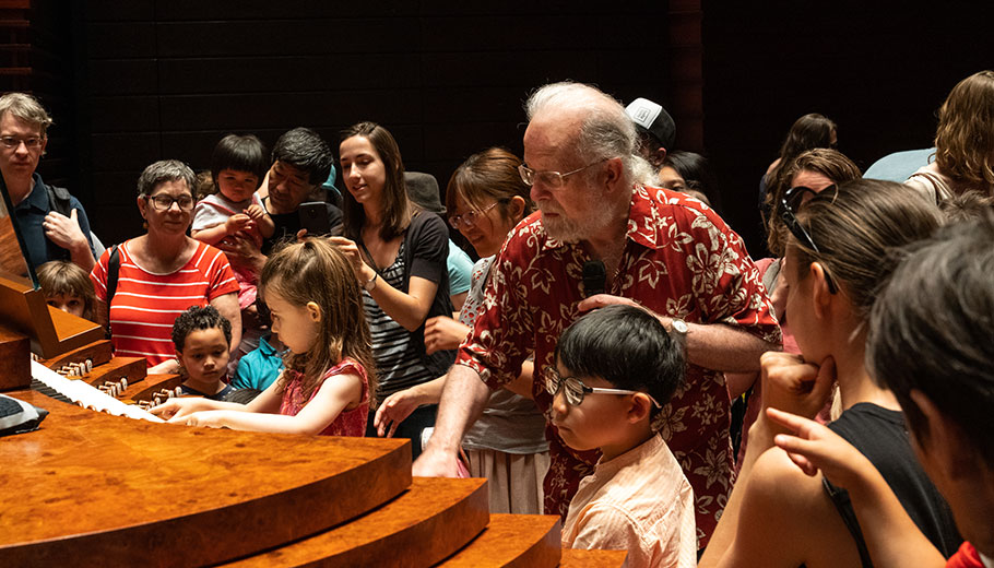 Michael Barone demonstrates the organ for a group of children at the Kimmel Center