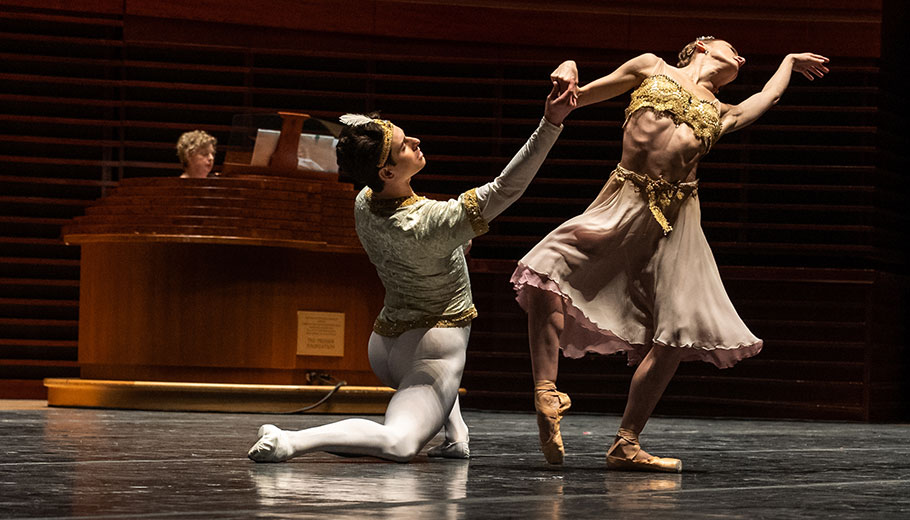 ballet dancers dance on stage while a woman plays the organ at the Kimmel Center