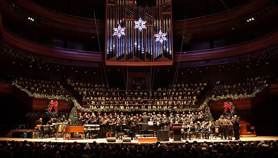 A Gathering of Choirs performing on stage in Verizon Hall decorated with holiday decorations