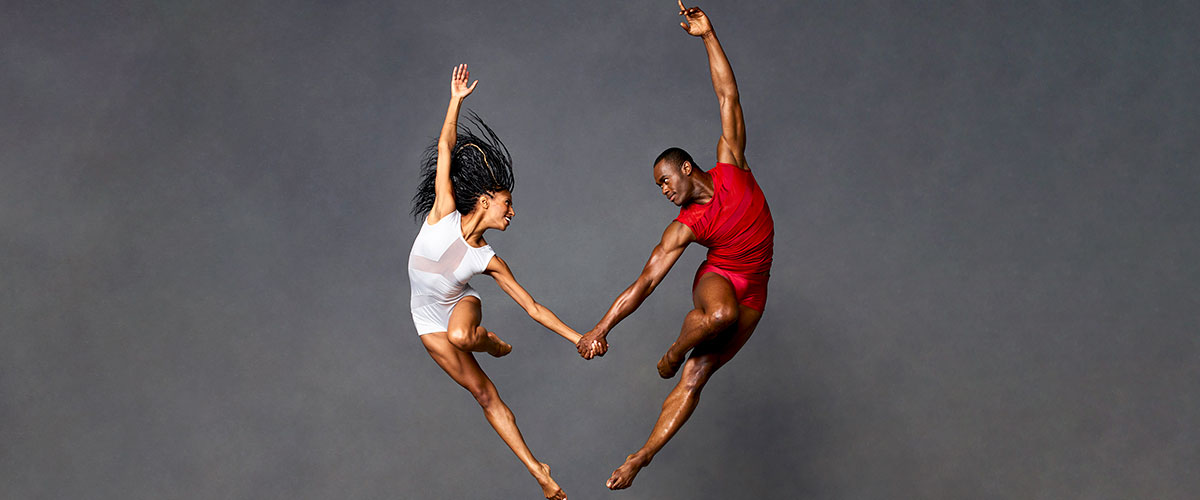 2 Actively Posed Dancers from Alvin Ailey American Dance Theater
