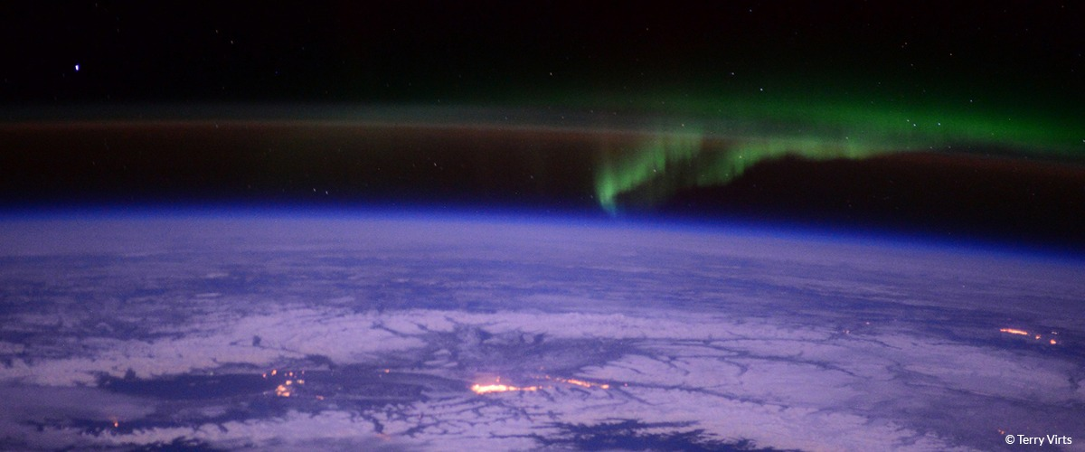 A view of Earth from space with the northern lights