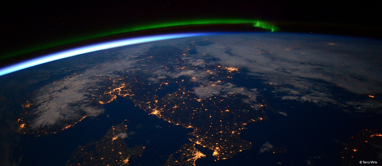 A view of earth from space with northern lights