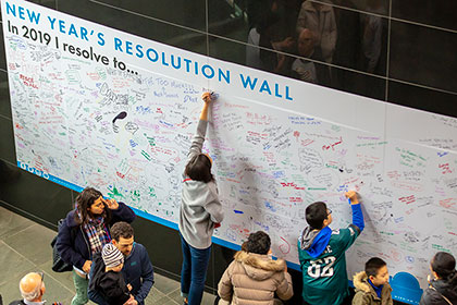 GUests write on the New Years Resolution wall inside the Kimmel Center on New Years Day