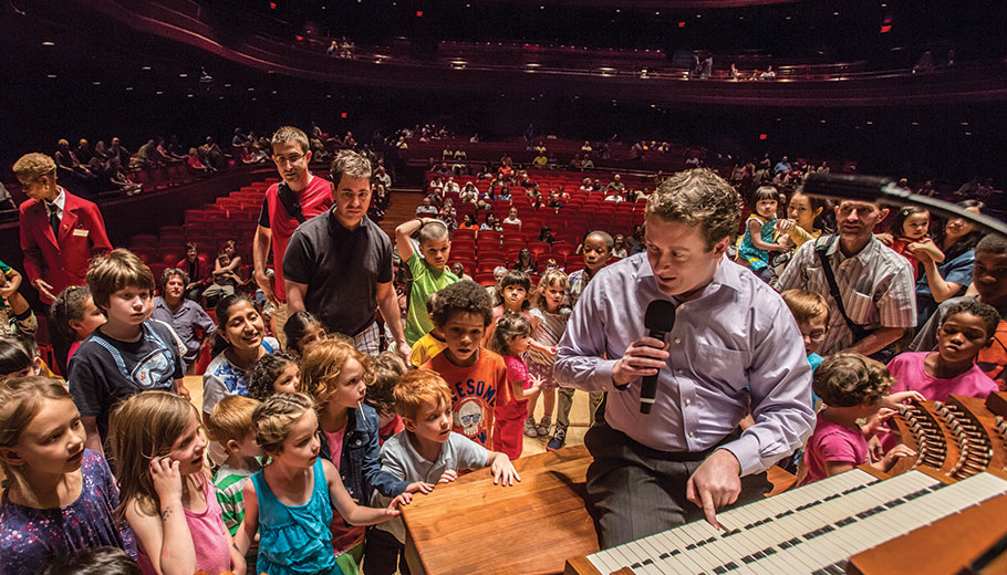 The organ is demonstrated to a large group of children