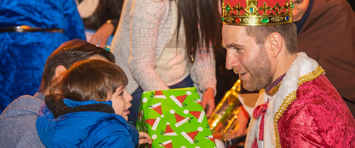 children look at gifts for three kings day