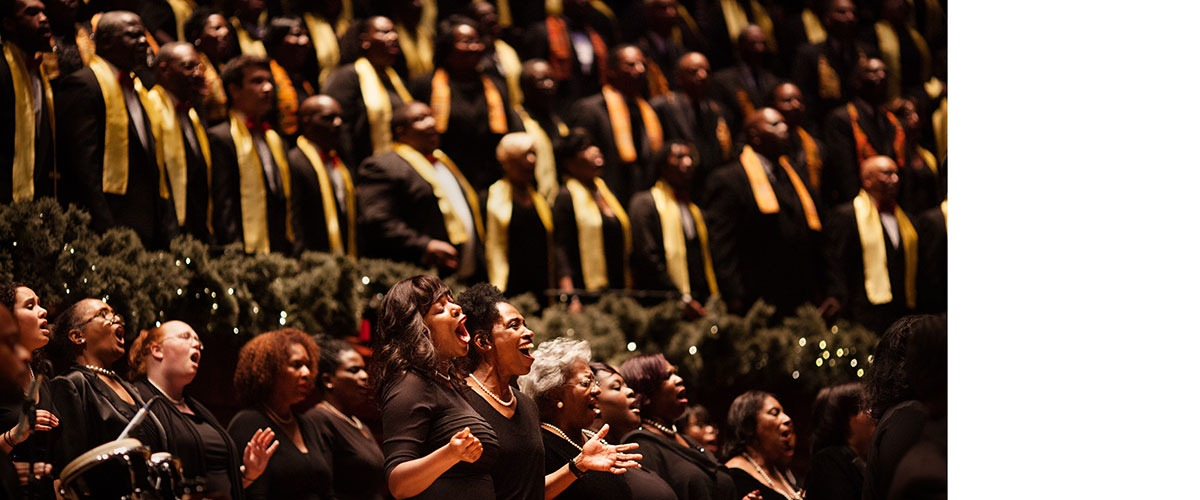 A choir performs on stage