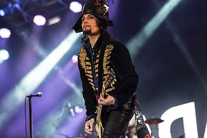 Adam Ant performs on stage