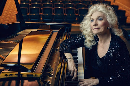 Judy Collins Pictured at the piano