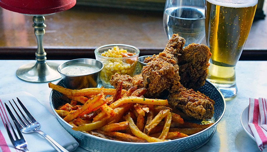 Fried chicken, fries, and a beer