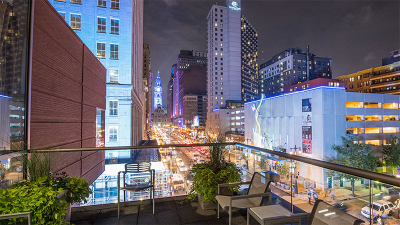 Guests step out onto a lovely outdoor balcony overlooking Philadelphia's famous Broad Street.