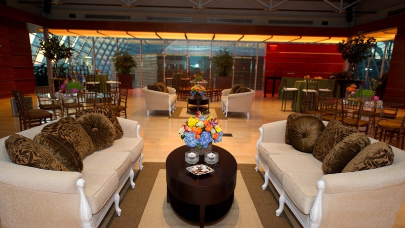 Guests opt for a professional atmosphere with the addition of suede couches and pillows for an event.
