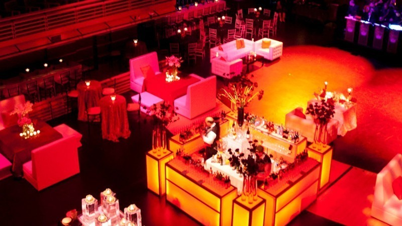 Bartenders prepare drinks as they wait for guests to arrive at the Perelman Theater.