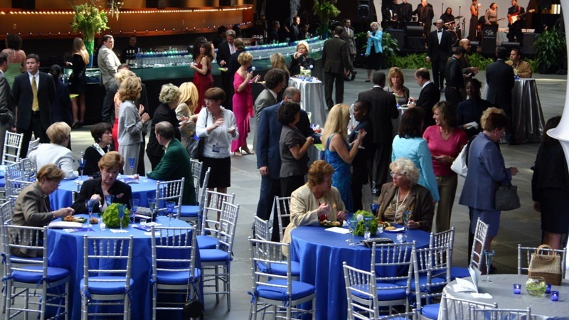 Guests enjoy a meal while networking and listening to live music at the Commonwealth Plaza.