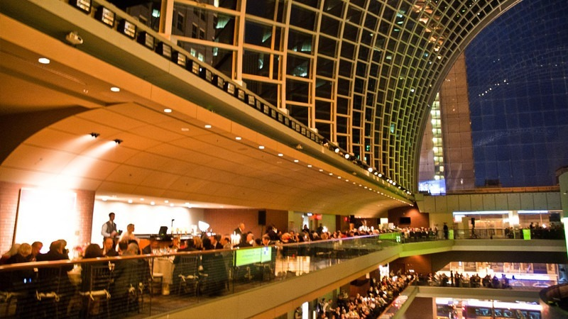 Guests enjoy their meals while admiring the view of the Kimmel Center that the First Tier Lounge offers.