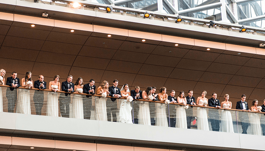 Wedding Party looks over the tier inside the Kimmel Center