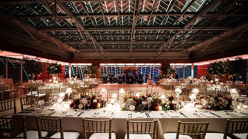 Tables have been arranged to make room for a dance floor in a gorgeous wedding reception.