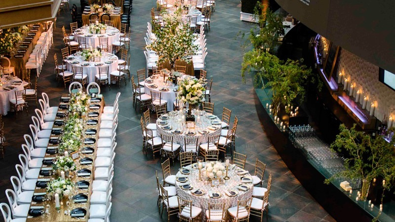 Rows of chairs and tables are set and waiting for wedding guests to arrive.